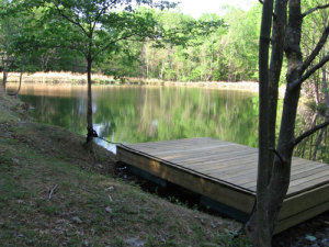 Take the oars to steer the swimming dock to the middle of the pond, and jump in. The pond straddles land owned by StillPoint and the Rolling Ridge Foundation.