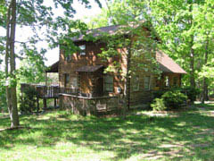 The Cabin is a 1300 square foot two-story log cabin built in 1985. The Retreat Cabin has central airconditioning and forced air heating, as well as a fireplace for additional heat.