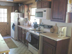 The kitchen is fully equipped with microwave, electric stove, refrigerator.