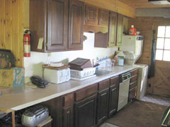 The kitchen also has a dishwasher, as well as a washer and dryer.