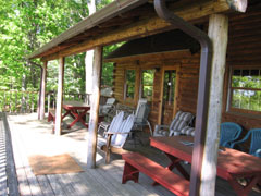 The cabin's large back porch offers a panoramic vista view of the Shenandoah River and Valley.